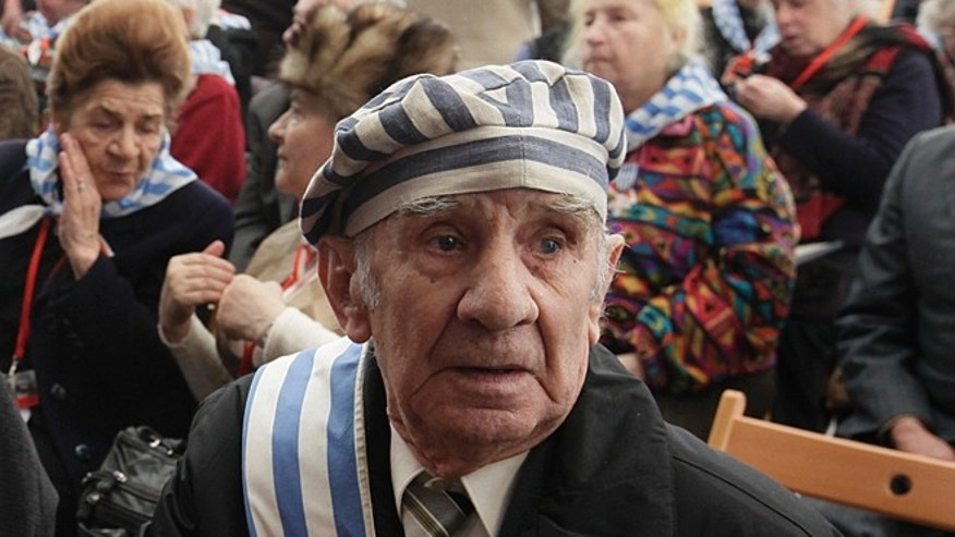 Jan. 27, 2013: Former prisoner Miroslaw Celka, 89, attends a ceremony at  the Auschwitz concentration camp  in Oswiecim, Poland, marking the 68th anniversary of the liberation of Auschwitz by Soviet troops and remembering  the victims of the Holocaust, in Auschwitz-Birkenau.