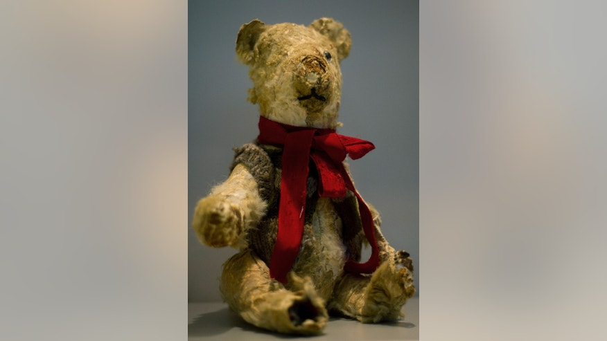 """Holocaust survivor Stella Knobel's teddy bear on display at the memorial's """"Gathering the Fragments"""" exhibit at Yad Vashem Holocaust memorial and museum in Jerusalem, Sunday, Jan. 27, 2013., Sunday, Jan. 27, 2013. When Stella Knobel's family had to flee World War II Poland in 1939, the only thing the 7-year-old girl could take with her was her teddy bear. For the next six years, the stuffed animal never left her side as the family wondered through the Soviet Union, to Iran and finally the Holy Land. """"He was like family. He was all I had. He knew all my secrets,"""" the 80-year-old now says with a smile. """"I saved him all these years. But I worried what would happen to him when I died."""" So when she heard about a project launched by Israel's national Holocaust memorial and museum to collect artifacts from aging survivors - before they, and their stories, were lost forever - she reluctantly handed over her beloved bear Misiu - Polish for """"Teddy Bear""""- so the fading memories of the era could be preserved for others. (AP Photo/Ariel Schalit)"""
