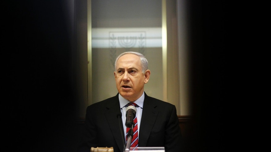 Israeli Prime Minister Benjamin Netanyahu heads the weekly Cabinet meeting at his Jerusalem office, Sunday, Jan. 27, 2013. (AP Photo/Ariel Schalit)