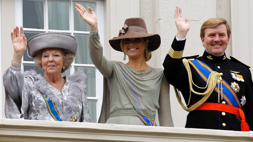 Sept. 20, 2011 - FILE photo of Dutch Queen Beatrix, left, Crown Prince Willem Alexander, right, and his wife Princess Maxima, center, wave to wellwishers from the balcony of Royal Palace Noordeinde.
