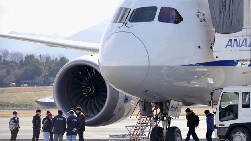 Jan. 18, 2013: In this file photo, officials inspect an All Nippon Airways Boeing 787 which made an emergency landing at Takamatsu airport in Takamatsu, western Japan.