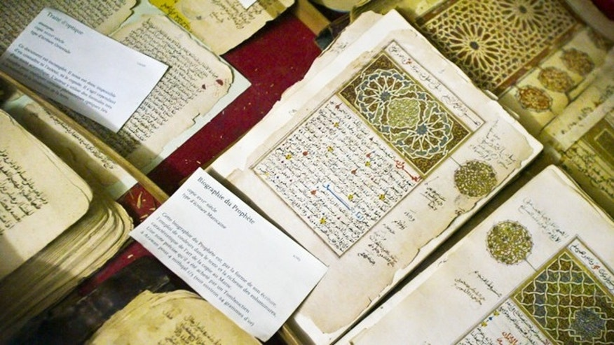 Mar. 16, 2004: Aome of the 20,000 preserved ancient Islamic manuscripts which rest in air-conditioned rooms are displayed at the Ahmed Baba Institute in Timbuktu, Mali. Islamist extremists torched the library containing the historic manuscripts in Timbuktu, the mayor of the town said Monday, Jan. 28, 2013.