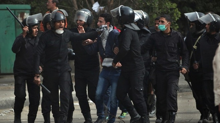 Jan. 27, 2013: Egyptian riot police arrest a protester during clashes near Tahrir Square, Cairo, Egypt. Clashes continued for the fourth successive day between protesters and police near Cairo's central Tahrir square, birthplace of the 2011 uprising. Police used tear gas, while the protesters pelted them with rocks.