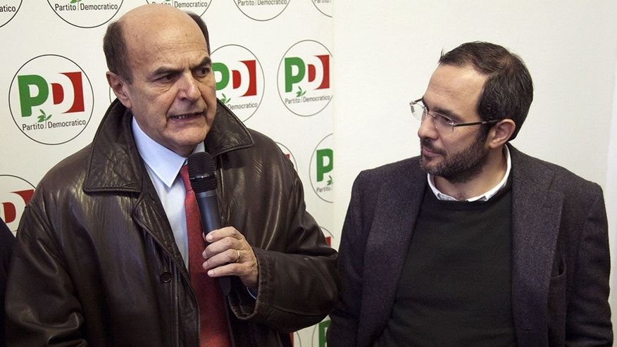 In this Jan. 19, 2013 photo Pier Luigi Bersani and Umberto Ambrosoli meet in Milan, Italy. Lombardy, Italy's most populous and economically productive region, is a key battleground in the upcoming national elections, with the regional race not only likely to determine who can most reliably govern the euro zone's third-largest economy but also testing emerging political alliances. Polls show that the center-right coalition led by Silvio Berlusconi and the center-left forces backing Democratic Party leader Pier Luigi Bersani's bid for premier are neck-and-neck in Lombardy, geographically centered around the financial and fashion capital Milan, marking the first time in the Berlusconi era that the left has had such a strong showing in region where the media mogul made his mark. (AP Photo/Alessandro Treves, Lapresse) ITALY OUT