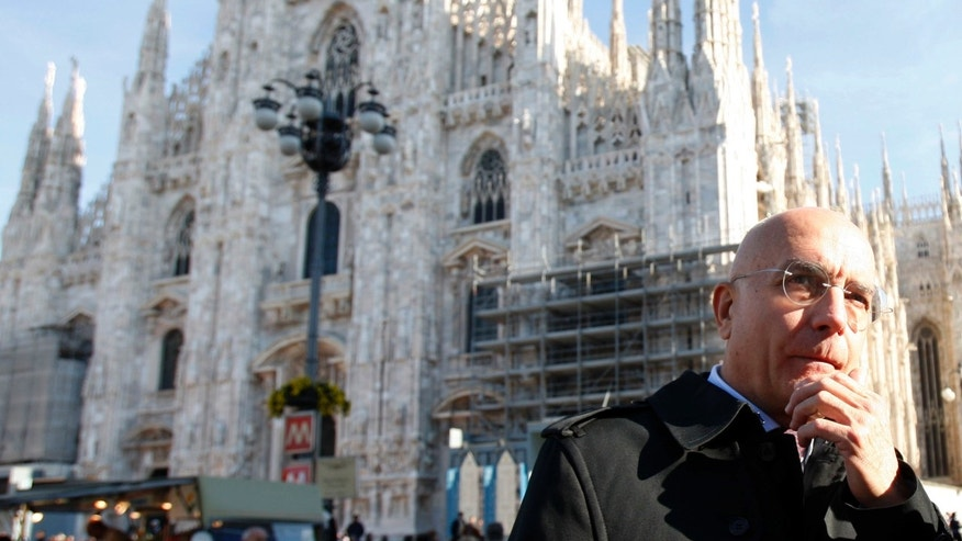 In this Nov. 8, 2008 photo, Gabriele Albertini stands in front of the Milan gothic cathedral, Italy. Lombardy, Italy's most populous and economically productive region, is a key battleground in the upcoming national elections, with the regional race not only likely to determine who can most reliably govern the euro zone's third-largest economy but also testing emerging political alliances. Polls show that the center-right coalition led by Silvio Berlusconi and the center-left forces backing Democratic Party leader Pier Luigi Bersani's bid for premier are neck-and-neck in Lombardy, geographically centered around the financial and fashion capital Milan, marking the first time in the Berlusconi era that the left has had such a strong showing in region where the media mogul made his mark. Playing spoiler is former Milan Mayor Gabriele Albertini, who after defecting from Berlusconi's People of Liberty Party in a spat has aligned himself with Premier Mario Monti's centrist forces. (AP Photo/Luca Bruno)