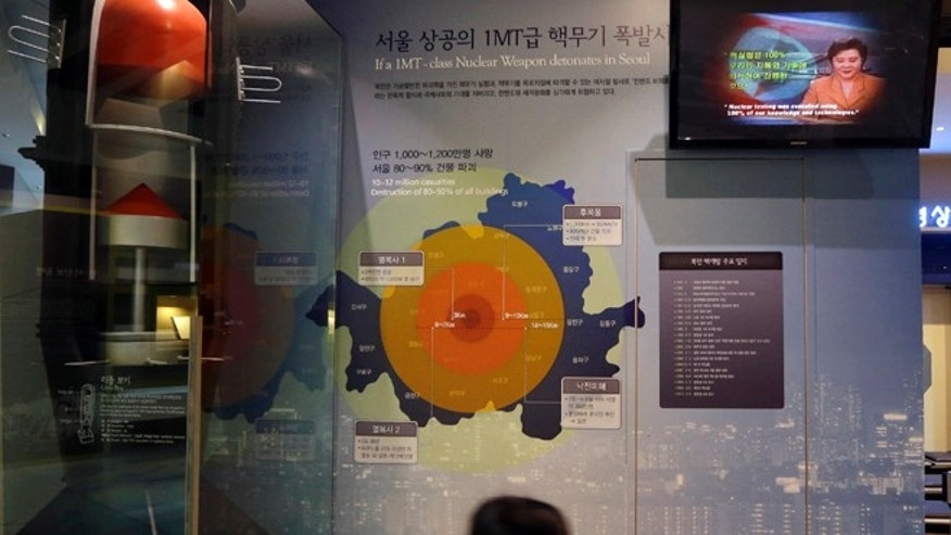 Jan. 29, 2013: A girl looks at a display on assessment about impact of supposed nuclear attack on Seoul at the Korea War Memorial Museum in Seoul, South Korea.