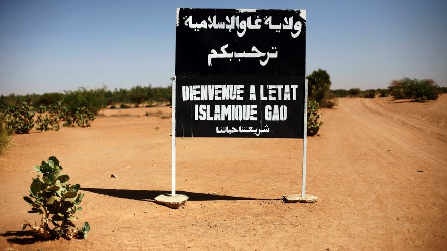 "A sign on the northern road exiting the town of Gao, Northern Mali, Wednesday Jan. 30, 2013, reads ""welcome to the islamic state of Gao"".  Islamist extremists fled the city Saturday after French, Chadian and Nigerien troops arrived, ending 10 months of radical islamic control over the city.(AP Photo/Jerome Delay)"