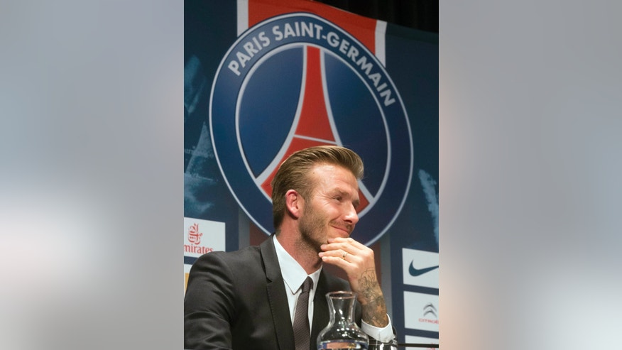British soccer player David Beckham, smiles during a press conference, in at the Parc des Princes stadium in Paris, Thursday, Jan. 31, 2013. David Beckham will join Paris Saint-Germain on Thursday, opting for a move to France after mulling over lucrative offers from around the world since leaving the Los Angeles Galaxy.(AP Photo/Michel Euler)
