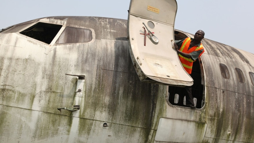 Jan. 31, 2013: A worker looks out from the fuselage of an abandoned aircraft at Murtala Muhammed International Airport in Lagos, Nigeria.