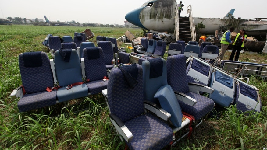 Jan. 31, 2013: Seats removed from the fuselage of an abandoned aircraft are piled up at Murtala Muhammed International Airport in Lagos, Nigeria.