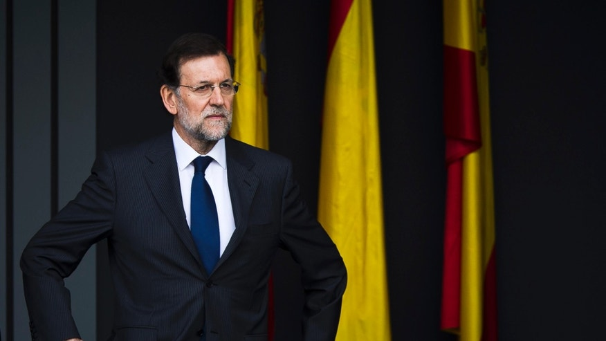 "FILE - In this Oct. 12, 2012 file photo, Spain's Prime Minister Mariano Rajoy attends a military parade in Madrid. Spain's governing Popular Party insists its financial accounts are totally legal and denies a newspaper report of regular under-the-table payments to leading members, including current Prime Minister Mariano Rajoy. The scandal first broke when after the National Court reported that former party treasurer Luis Barcenas amassed an unexplained euro 22 million ($30 million) in a Swiss bank account several years ago. In a statement Thursday Jan. 31, 2013,  the party denied the existence of ""hidden accounts"" or ""the systematic payment to certain people of money other than their monthly wages."" (AP Photo/Daniel Ochoa de Olza, File)"