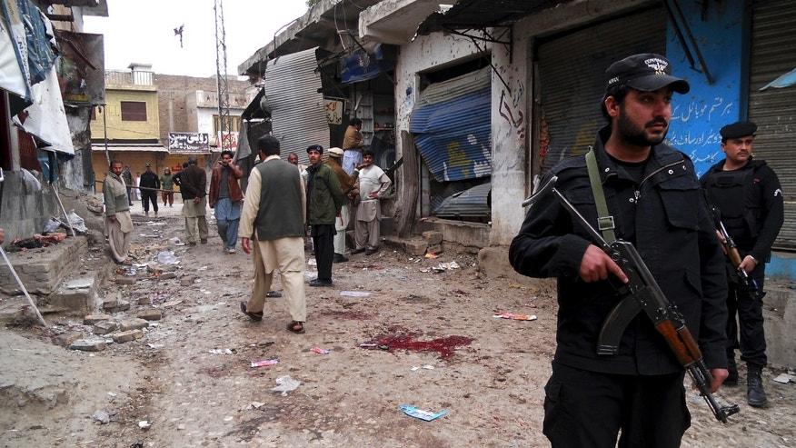 Feb 1, 2013 - Police commandos cordon off an area after a blast in Hangu, Pakistan.