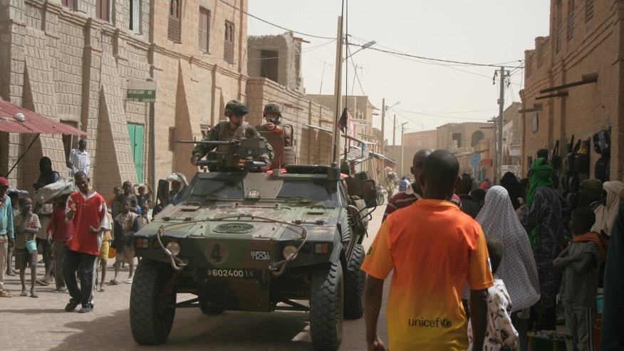 Jan. 31, 2013 - French soldiers are watched by local people, as they drive through the city streets of Timbuktu, Mali.