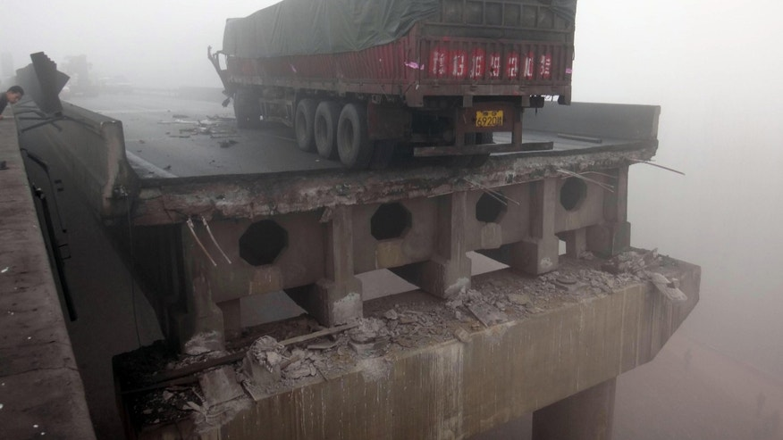 Feb. 1, 2013: In this photo provided by China's Xinhua News Agency, a truck sits on the expressway bridge which partially collapsed due to an explosion in Mianchi County, Sanmenxia, central China';s Henan Province.