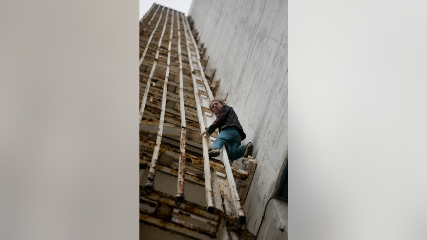 "Alain Robert, known as ""Spiderman,"" practices climbing a section of the Habana Libre hotel in Havana, Cuba, Friday, Feb. 1, 2013.  Robert, from France, plans to climb the 27 floor hotel on Monday, without any security instruments. (AP Photo/Ramon Espinosa)"