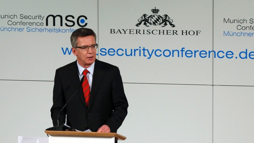 German Defence Minister Thomas de Maiziere delivers a speech at the Munich Security Conference in Munich, southern Germany, on Friday, Feb. 1, 2013. The 49th Munich Security Conference starts Friday afternoon with experts from 90 delegations including US Vice President Joe Biden. (AP Photo/Matthias Schrader)