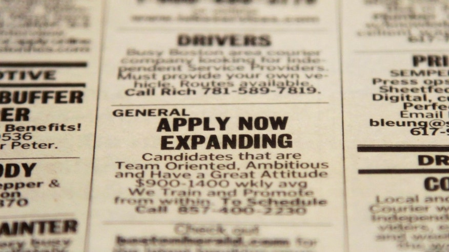 FILE - In this Tuesday, Dec. 11, 2012 file photo, an advertisement in the classified section of the Boston Herald newspaper calls attention to possible employment opportunities in Walpole, Mass. U.S. employers added 155,000 jobs in December, a steady gain that shows hiring held up during the tense negotiations to resolve the fiscal cliff.  The solid job growth wasn't enough to push down the unemployment rate, which remained 7.8 percent last month, the Labor Department said Friday, Jan. 4, 2013. The rate for November was revised up from an initially reported 7.7 percent.  (AP Photo/Steven Senne, File)