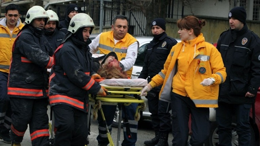 Feb. 1: Medics carry an injured woman on a stretcher to an ambulance after a suspected suicide bomber detonated an explosive device at the entrance of the U.S. Embassy in the Turkish capital, Ankara.