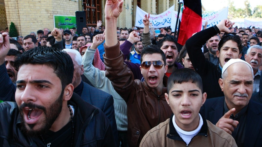 Feb. 1, 2013 - Iraqis chant anti-government slogans during a protest in Baghdad, Iraq.