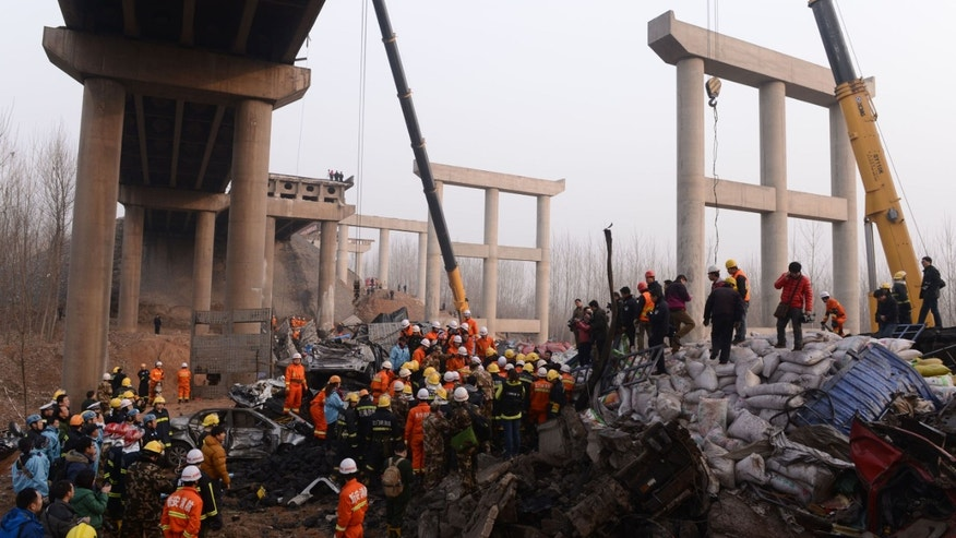 In this Feb. 1, 2013 photo provided by China's Xinhua News Agency, rescuers work at the accident locale where an 80 meter (260 foot) section of an expressway bridge collapsed in Mianchi County, Sanmenxia City in central China's Henan Province.  An elevated portion of highway in central China collapsed on Friday after a truck loaded with fireworks for Lunar New Year celebrations exploded, killing at least nine people and sending vehicles plummeting 30 meters (about 100 feet) to the ground. (AP Photo/Xinhua, Zhao Peng) NO SALES