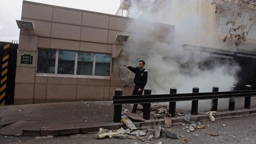 Feb. 1, 2013: An embassy security guard asks for help at the US embassy just minutes after a suicide bomber has detonated an explosive device at the entrance of the U.S. Embassy in the Turkish capital, Ankara, Turkey.