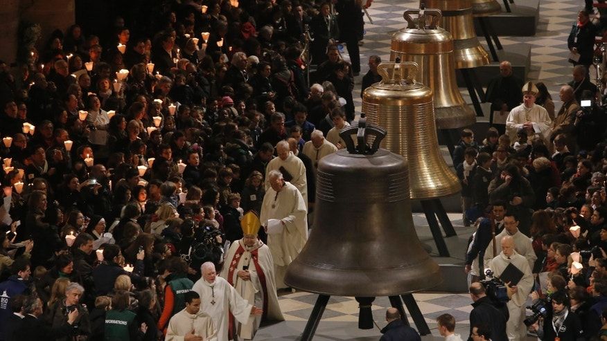 Some of the nine new bronze bells are displayed in Notre Dame cathedral during a ceremony of blessing by Paris Archbishop Andre Vingt-Trois in Paris, Saturday, Feb. 1, 2013. Nine enormous new bronze bells have made their way at Notre Dame Cathedral, helping the medieval edifice to rediscover its historical harmony. (AP Photo/Francois Mori)