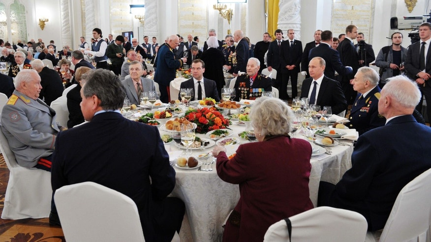 Russian President Vladimir Putin, third right, and Prime Minister Dmitry Medvedev, center back, meet with World War II veterans at a reception marking the 70th anniversary of the Battle of Stalingrad, in the Kremlin in Moscow, Friday, Feb. 1, 2013. The Battle of Stalingrad was a turning point in World War II that led to the defeat of the Nazi Germany in the east. (AP Photo/RIA-Novosti, Alexei Nikolsky, Presidential Press Service)