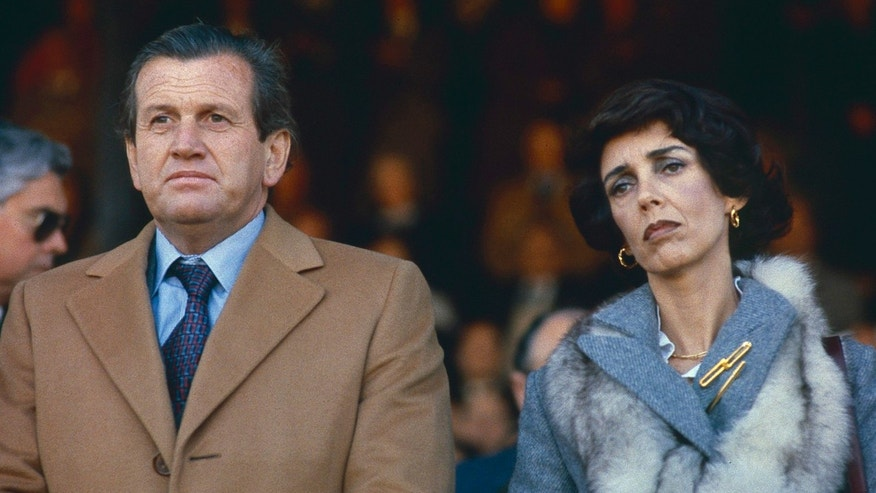In this picture taken in 1979, Jorge Zorreguieta, left, father of Argentinean born Princess Maxima Zorreguieta of Holland, and his wife Maria del Carmen Cerruti, attend the inauguration of the Rural Exhibition, an annual agricultural and livestock show, in Buenos Aires, Argentina. Prince Willem-Alexander's ascension to the Dutch throne in April 2013 promises to be a shining moment on the world stage for his wife Maxima and her home country of Argentina. But there will be a glaring absence at the ceremony. Queen Beatrix's announcement this week that she'll step aside and let her son become king raised new questions about the future queen's father, Jorge Zorreguieta, one of the longest-serving civilian ministers in Argentina's 1976-1983 military dictatorship. (AP Photo)