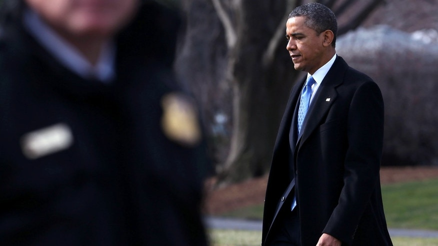 WASHINGTON, DC - FEBRUARY 04:  U.S. President Barack Obama walks toward Marine One while departing the White House, February 4, 2013 in Washington, DC. President Obama is traveling to Minnesota to rally support for his new gun control proposals.  (Photo by Mark Wilson/Getty Images)