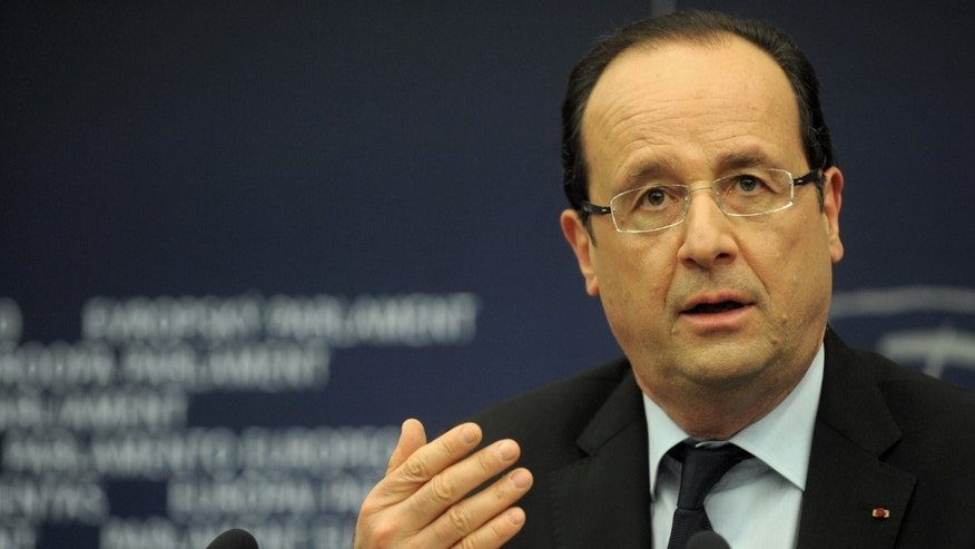 French president Francois Hollande gestures during apress conference at the European Parliament Tuesday, Feb. 5, 2013, in Strasbourg, eastern France. Hollande warns of a tough European Union summit later this week if countries including Britain continue to demand drastic cuts to the EU budget while refusing to make concessions themselves.  (AP Photo/Christian Lutz)