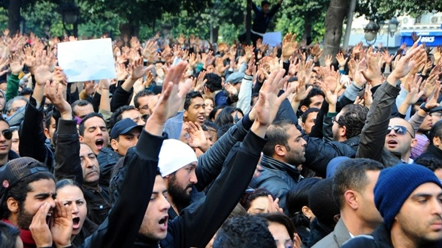 Feb.6, 2013: Protesters gather on Tunis' main avenue after a Tunisian opposition leader critical of the Islamist-led government was gunned down as he left home.