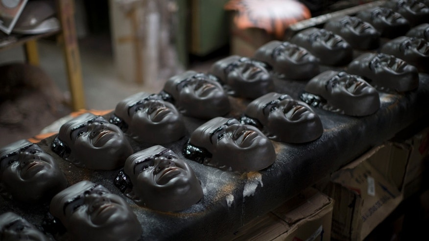 In this Jan. 21, 2013 photo, Carnival masks in the likeness of Brazilian Supreme Court Justice Joaquim Barbosa air drys on an assembly line at the Condal factory in Sao Goncalo, near Rio de Janeiro, Brazil. Condal is Brazil's oldest and most productive mask factory that is run by Olga Valles, a family business started in 1958. Barbosa, born into poverty, became the first black judge in the nation's top court when he took office in 2003. Barbosa went on to make a name for himself when he presided over a wide-ranging political corruption trial involving a cash-for-votes scheme. Now, average Brazilians are honoring him during Carnival by buying his mask in droves, said Valles. Brazil's annual five-day extravaganza begins Friday. (AP Photo/Felipe Dana)