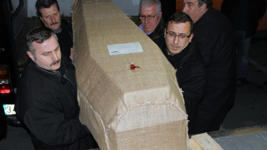 People carry a casket carrying the remains of New York City woman Sarai Sierra, 33, found dead while on a solo vacation in Istanbul, before loading into a plane bound for New York at the Ataturk Airport in Istanbul, Turkey, late Wednesday, Feb. 6, 2013. Her body is being returned home Thursday.(AP Photo/IHA) TURKEY OUT - INTERNET OUT