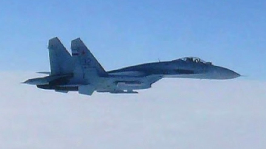 Feb. 7, 2013: In this photo taken by Japan Air Self-Defense Force and released by the Joint Staff Office of the Defense Ministry of Japan, a Russian fighter jet SU-27 flies over the sea off the Japanese island of Hokkaido Thursday afternoon. The Defense Ministry said two SU-27 jets, including the one shown in this photo, briefly intruded into Japanese airspace in the afternoon off the coast of Rishiri island on Hokkaido's west coast, prompting Japans air force to scramble jets.