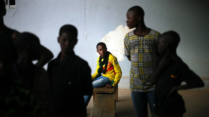 Malian teenagers gather outside a restaurant after Nigeria defeated Mali in the Africa Cup of Nations semifinal soccer match played in South Africa, Gao, northern Mali, Wednesday, Feb. 6, 2013.(AP Photo/Jerome Delay)