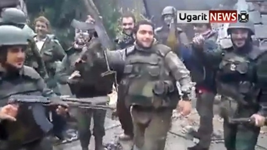 "Feb. 7, 2013: This image taken from video obtained from Ugarit News, which has been authenticated based on its contents and other AP reporting, purports to show Syrian soldiers dancing to Usher's hit song ""Yeah!"""