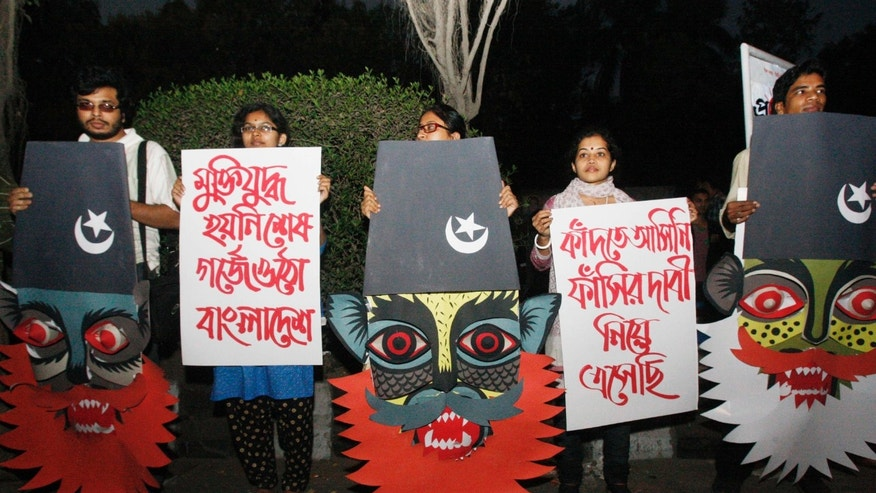 "Bangladeshi activists attend a rally to demand executions for people convicted of war crimes involving the nation's independence war in 1971, in Dhaka, Bangladesh, Friday, Feb. 8, 2013. The protesters in Dhaka urged Prime Minister Sheikh Hasina to review a verdict sentencing a senior leader of Islamic party Jamaat-e-Islami to life in prison for killings and other crimes. The protesters said the life term was not enough as Abdul Quader Mollah was found by a tribunal guilty of five charges, including playing a role in the killing of 381 unarmed civilians. Placards read ""we demand death penalty for war criminals,"" right, and ""Liberation war has not ended. Bangladesh will fight again."" (AP Photo/Pavel Rahman)"