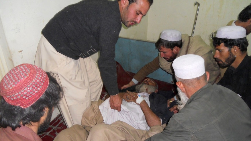 Feb. 8, 2013 - Pakistani villagers shift an injured man to a bed at a local hospital in Kohat, Pakistan.