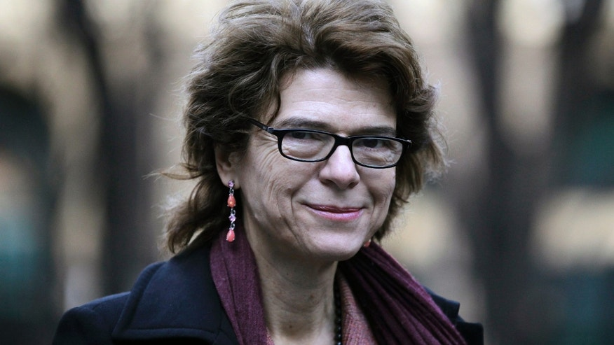Vicky Pryce, ex-wife of former Energy Secretary Chris Huhne arrives at Southwark Crown Court in London for her trial hearing accused of perverting the course of justice, Monday, Feb. 4, 2013. Former government Energy Secretary Chris Huhne and his ex-wife Vicky Pryce appear in court to face charges of perverting the course of justice relating to Huhne allegedly asking his then wife Pryce to take penalty points for a car speeding offence almost a decade ago.  Member of Parliament Huhne resigned from the cabinet after the Crown Prosecution Service announced that he and Pryce would face charges.(AP Photo/Sang Tan)