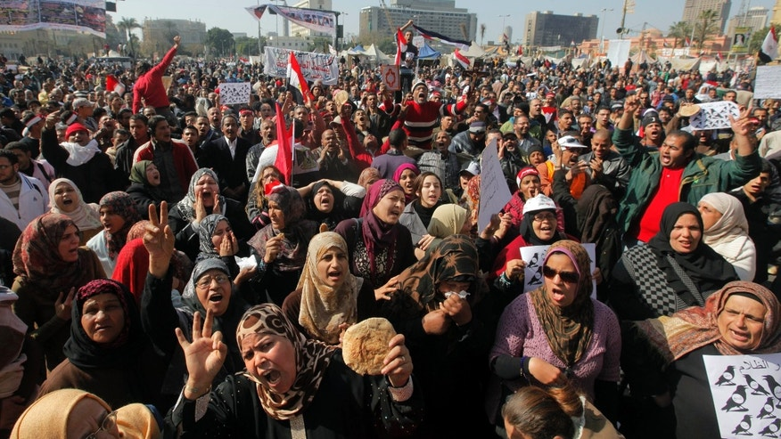 Feb. 8, 2013 - Egyptian protesters shout anti-government slogans and display bread to symbolize the high number of people living in poverty, during a protest in Tahrir Square, in Cairo, Egypt.