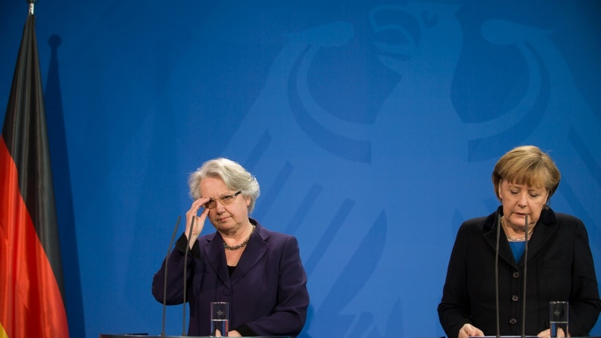 German chancellor Angela Merkel , right, and education minister  Annette Schavan, left, address the press  in Berlin Saturday, Feb. 9, 2013. Germany's education minister has resigned after a university decided to withdraw her doctorate, finding that she plagiarized parts of her thesis - an embarrassment for Chancellor Angela Merkel's government months before national elections.  (AP Photo/dpa, Wolfgang Kumm)