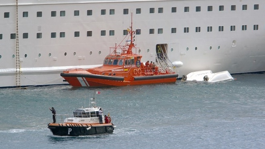 Feb. 10, 2013: An orange rescue boat is seen docked by a capsized lifeboat from the British-operated cruise ship Thomson Majesty in Santa Cruz port of the Canary Island of La Palma, Spain.  The lifeboat from the Thomson Majesty fell into the sea at port in Spains Canary Islands, killing five people and injuring three others Sunday, officials said. Spanish national broadcaster RTVE said an emergency training drill was taking place at the time of the accident.