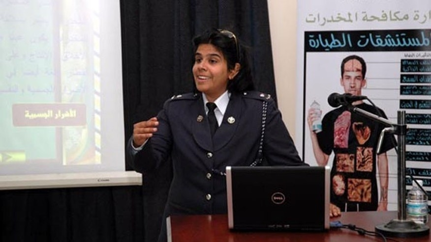 The princess, who works as a police officer, is accused of torturing two doctors who tried to help protesters (Bahrainrights.org)