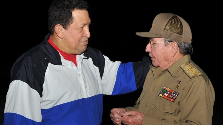 Dec. 10, 2012: In this file photo released by Cuba's state newspaper Granma, Cuba's President Raul Castro, right, receives Venezuela's President Hugo Chavez at the Jose Marti International airport in Havana, Cuba.