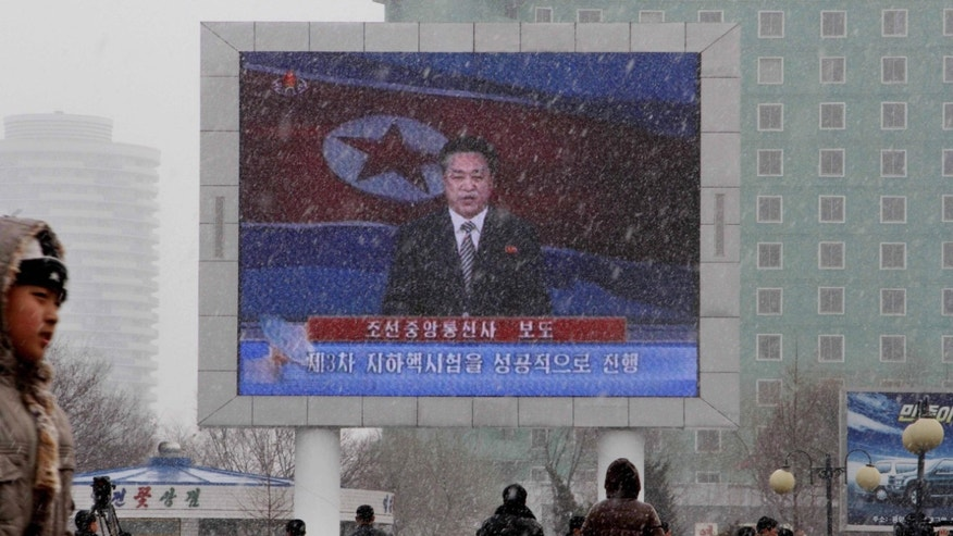 "On a large television screen in front of Pyongyang's railway station, a North Korean state television broadcaster announces the news that North Korea conducted a nuclear test on Tuesday, Feb. 12, 2013. North Korea conducted a nuclear test at an underground site in the remote northeast Tuesday, taking an important step toward its goal of building a bomb small enough to be fitted on a missile that could reach United States. The TV screen text reads: ""Korean Central News Agency reports,"" and ""The third underground nuclear test successfully conducted.""(AP Photo/Kim Kwang Hyon)"