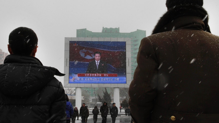 """On a large television screen in front of Pyongyang's railway station, a North Korean state television broadcaster announces the news that North Korea conducted a nuclear test on Tuesday, Feb. 12, 2013. North Korea conducted a nuclear test at an underground site in the remote northeast Tuesday, taking an important step toward its goal of building a bomb small enough to be fitted on a missile that could reach United States. The TV screen text reads """"Korean Central News Agency reports,"""" and """"The third underground nuclear test successfully conducted."""" (AP Photo/Jon Chol Jin)"""