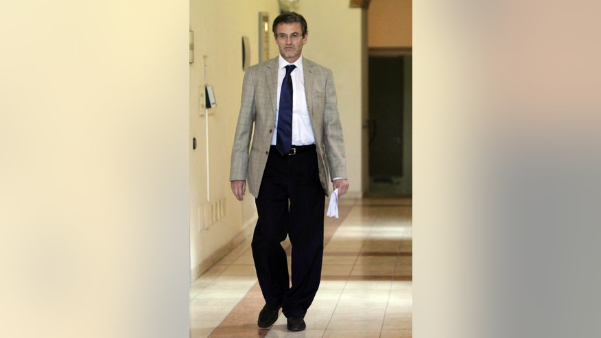 FILE  - In this Wednesday, June 8, 2011 file photo prosecutor Roberto Di Martino walks at the court in Cremona, Italy.  Two years ago, a curious case landed on the desk of Italian prosecutor Roberto Di Martino in the town of Cremona. Five players on the local third-division club Cremonese fell ill after a match against Paganese. One of the sick players got into an auto accident and club management reported the mysterious circumstances to police. (AP Photo/Antonio Calanni, File)