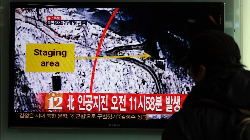 "A South Korean passenger watches TV news reporting an earthquake in North Korea, at the Seoul train station in Seoul, South Korea, Tuesday, Feb. 12, 2013. The U.S. Geological Survey on Tuesday detected a magnitude 4.9 earthquake in North Korea. Neither Pyongyang nor Seoul confirmed whether North Korea had conducted its widely anticipated third nuclear test, though an analyst in Seoul said a nuclear detonation was a ""high possibility."" The Korean letters on the screen read: ""North, artificial earthquake 11:58 a.m."" (AP Photo/Lee Jin-man)"
