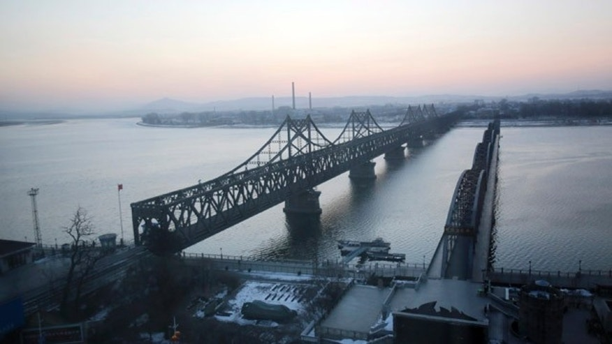 Feb. 7, 2013: The Friendship Bridge, left, linking China and North Korea, and the Yalu River Bridge, right, are seen before daybreak in Dandong, China, opposite the North Korean border town of Sinuiju.