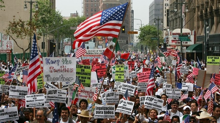 Thousands of demonstrators march through downtown to City Hall in one of several May Day marches and rallies in southern California and in at least 75 cities nationwide to press for immigrant and labor rights May 1, 2007 in Los Angeles, California. (Photo by David McNew/Getty Images)